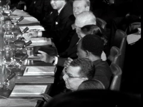 commonwealth prime minister's conference opens; england: london: marlborough house: int gv delegates round conference room table: pan table l-r: sir... - alec douglas home video stock e b–roll