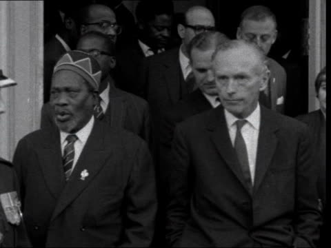 commonwealth prime ministers' conference: second day:; england: london: marlborough house: mr eric williams of trinidad out past mr jomo kenyatta sir... - alec douglas home video stock e b–roll