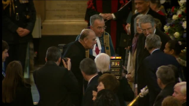 vídeos de stock e filmes b-roll de commonwealth service interiors dean of westminster the very reverend dr john hall welcomes prince philip / duke and dean into abbey / philip shaking... - clero