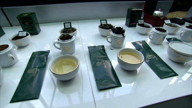 Commonwealth summit Prince Charles visits tea plantation Tea tasting equipment cups and bowls laid out on table / 'HRH Prince of Wales' Blend' / 'HRH...