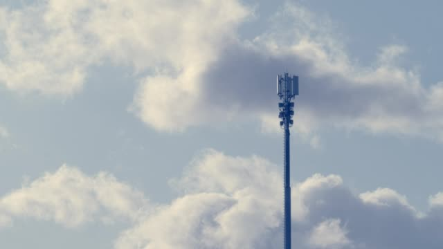 communication tower clouds - antenna aerial stock videos & royalty-free footage
