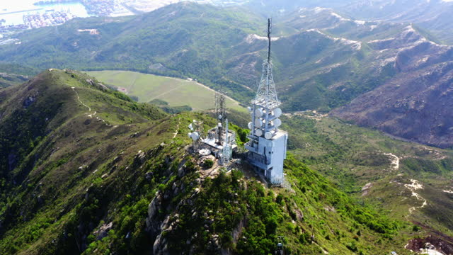 communication towers in the mountain - westernisation stock videos & royalty-free footage