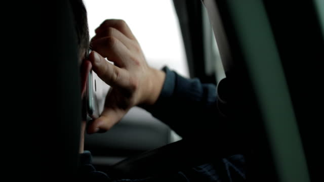 communication while driving - careless stock videos & royalty-free footage