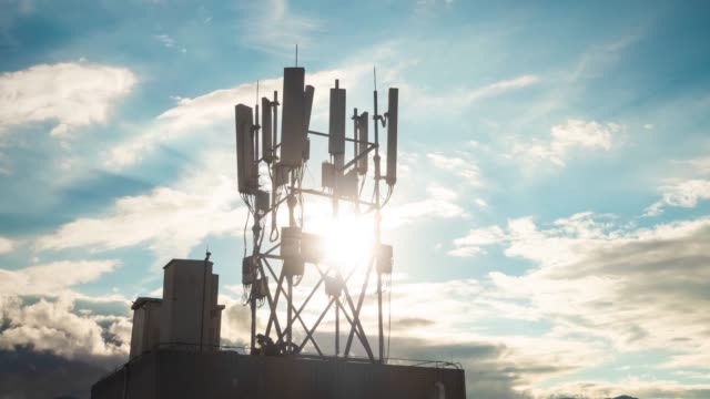 5g communications tower at sunset time-lapse - tower stock videos & royalty-free footage