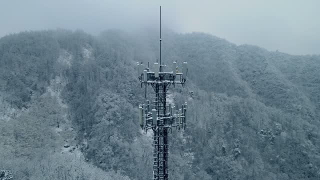 communications tower in winter mountain - radio broadcasting stock videos & royalty-free footage