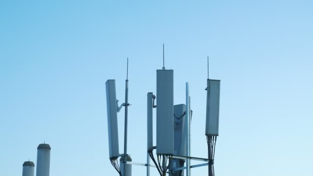 5g communications tower on top of buildings - cable stock videos & royalty-free footage