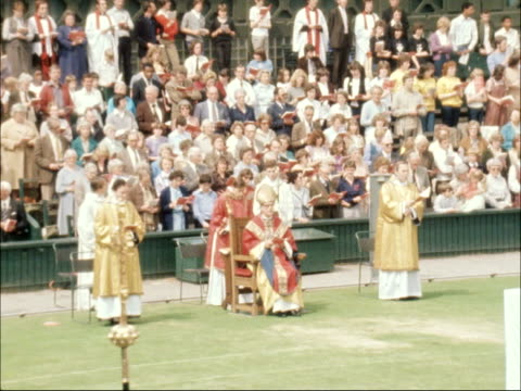 communion service held on centre court at wimbledon england london wimbledon all england lawn tennis club ext communion service being held on the... - 75th anniversary stock videos & royalty-free footage