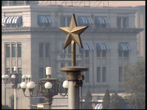 communism: chinese star atop building - letterbox format stock videos & royalty-free footage