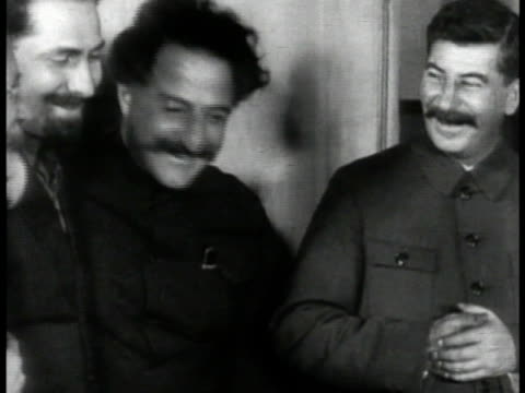 communist dictator josef stalin premier of the soviet union standing talking laughing w/ other government officials - 1935 stock-videos und b-roll-filmmaterial