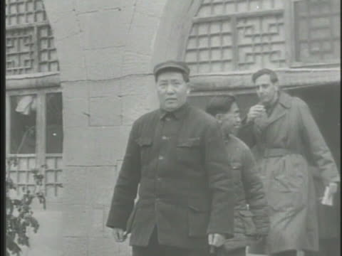communist leader mao zedong exiting building, walking w/ other officials. chinese revolution, people's republic of china , maoism, people's... - mao tse tung video stock e b–roll