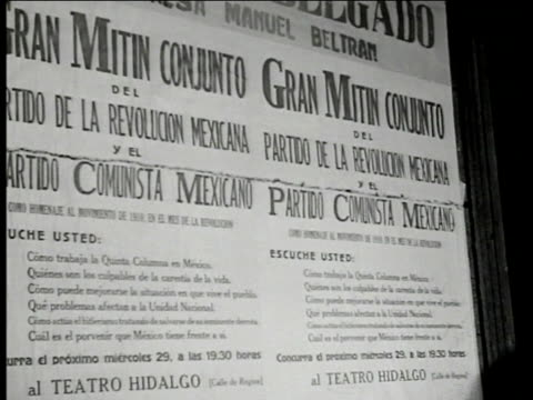 communist meeting poster 'comunista mexicano.' members listening. communist banner. communist leaders on stage, one at microphone talking, mexico... - communist flag stock videos & royalty-free footage