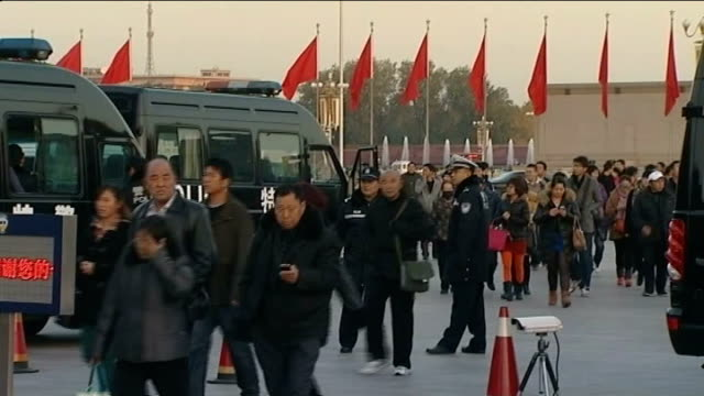 leadership transition / corruption warning china beijing tiananmen square members of public leaving tiananmen square as it is cleared by police... - chinese communist party stock videos and b-roll footage