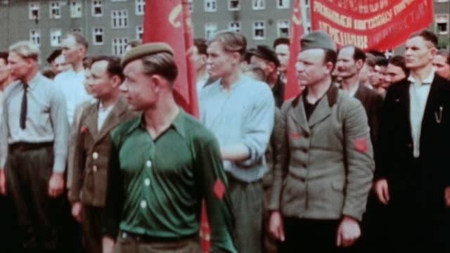 communist party demonstration with red flags and portrait of stalin / germany - 1945 stock-videos und b-roll-filmmaterial