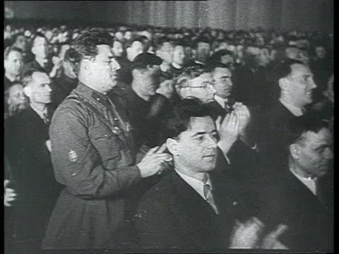 Communist Party of the Soviet Union Congress audience cheering Stalin Voroshilov Kaganovich young girls and boys from Communist Youth pioneers in...