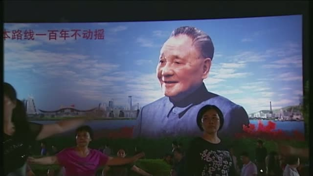 communist party votes to insert president xi jinping's name and ideas into constitution t08111230 / tx general views of people performing evening... - communist party stock videos and b-roll footage