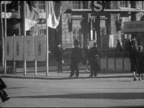 communist police crossing street at potsdam square w/ communist banners . vs germans privately exchanging east mark w/ deutsche mark out on streets... - potsdamer platz stock videos & royalty-free footage