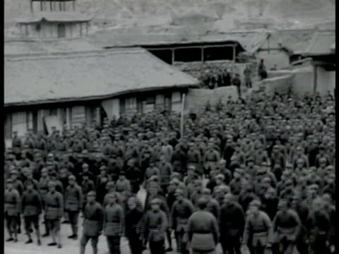 communist red army headquarters. communist red army soldiers gathered in courtyard, standing, then quickly sitting on command. vs seated soldiers.... - communism stock videos & royalty-free footage