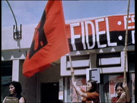 communist students with red flags and banners listen to speech by president fidel castro of cuba during official visit to antofagasto chile 15 nov 71 - fidel castro stock videos and b-roll footage