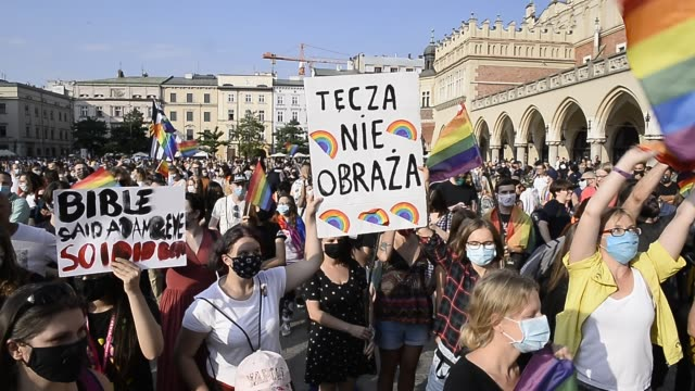 community and supporters wear protective face masks and dance during the 2020 equality march on the unesco listed main square on august 29, 2020 in... - poland stock videos & royalty-free footage