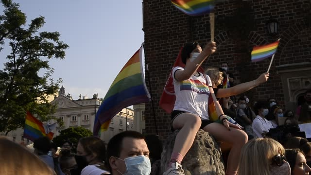 lgbt community and supporters wear protective face masks and wave rainbow flags during the 2020 equality march on the unesco listed main square on... - poland stock videos & royalty-free footage
