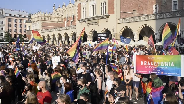 community and supporters wear protective face masks clap hands after a speech during the 2020 equality march on the unesco listed main square on... - poland stock videos & royalty-free footage