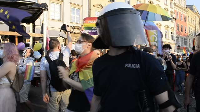 """community and supporters wear protective face masks shout slogans saying """"krakow against homophobia"""" during the 2020 equality march on the unesco... - poland stock videos & royalty-free footage"""