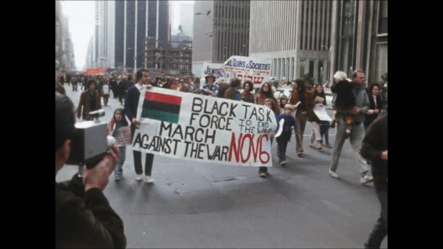 community groups walking against the vietnam war on the streets of nyc. - protestor stock videos & royalty-free footage