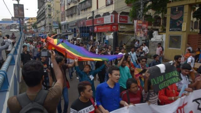 community participates in a pride rally celebrating anniversary of repealing a colonial-era criminal law in kolkata, india, sunday, sept. 8, 2019.... - kolkata stock videos & royalty-free footage