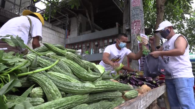 community-run stalls offering free food to the needy have multiplied across the philippines, with many struggling to feed their families as... - eating stock videos & royalty-free footage