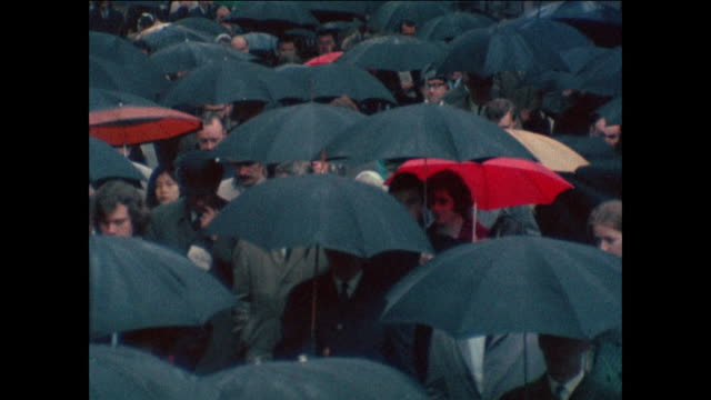commute in the rain - umbrella stock videos & royalty-free footage