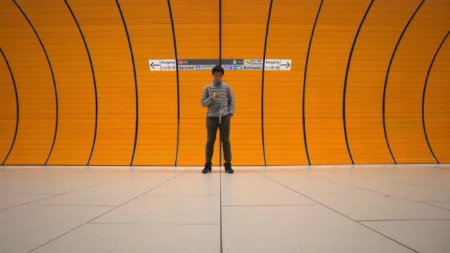 commuter at subway platform in munich - subway platform stock videos & royalty-free footage