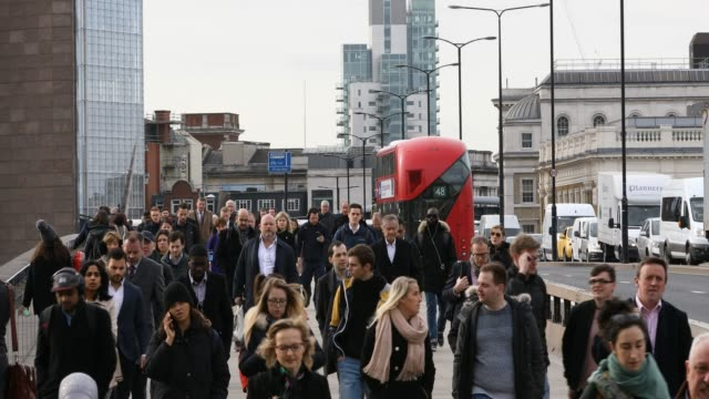 commuter crowd in london bridge - pedestrian stock videos & royalty-free footage