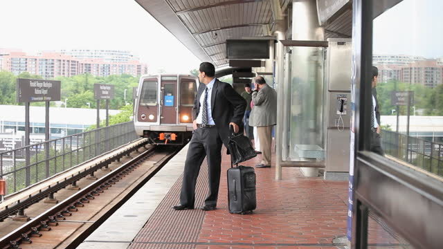 commuter in train station - underground train stock videos & royalty-free footage
