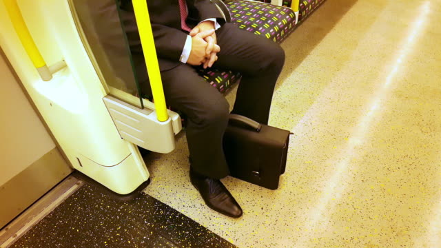 commuter riding the underground train - vehicle seat stock videos & royalty-free footage