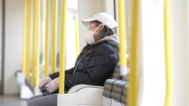 commuter sits on an empty district line tube carriage on march 31, 2020 in london, england. coronavirus pandemic has spread to at least 182... - commuter stock videos & royalty-free footage