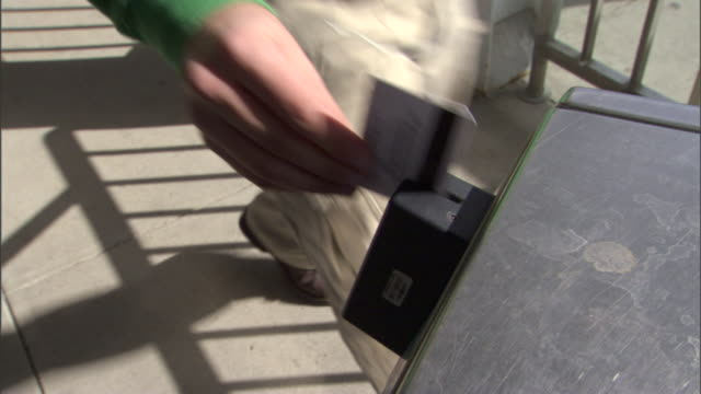 a commuter slides his card and selects his destination. - punch card reader stock videos & royalty-free footage