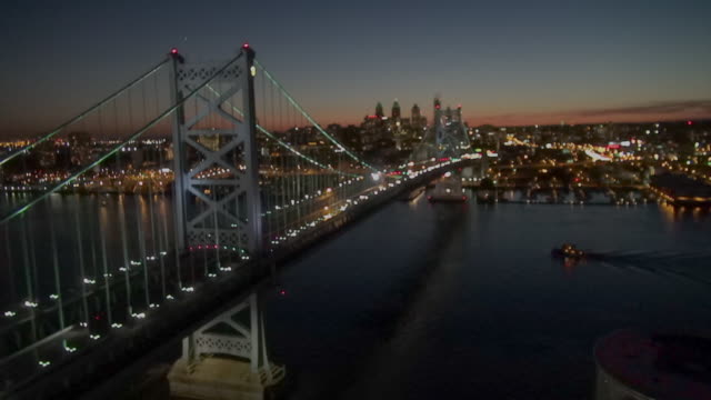 Commuter traffic crosses the Delaware River on the Ben Franklin Bridge late in the day.