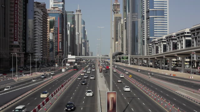 Commuter traffic uses Sheikh Zayed Road which is lined by the MTR elevated railway and skyscrapers in downtown Dubai.