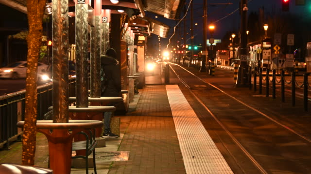 MAX commuter train arrives at local station at dusk, Portland, Oregon