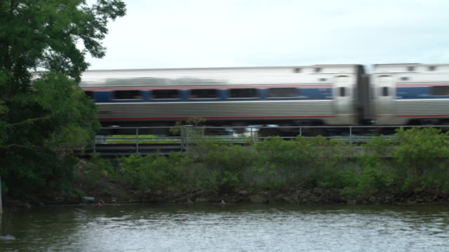 commuter train crossing the hudson river - hudson river stock videos & royalty-free footage