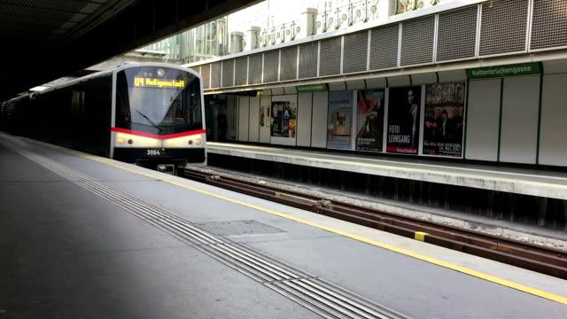 commuter train entering station in vienna - underground station platform stock videos & royalty-free footage