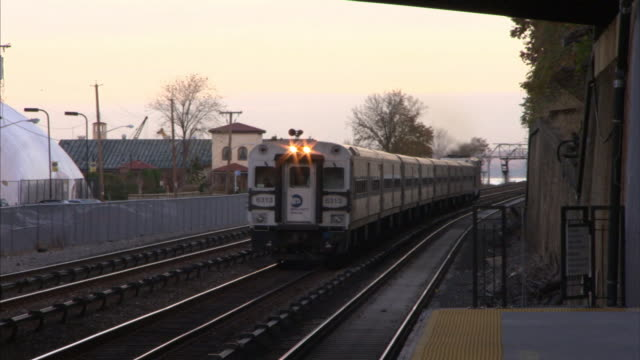 A commuter train passes a platform at Hudson Station in New York City.