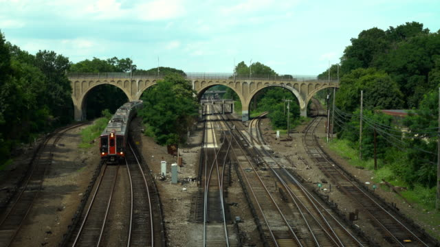 a commuter train passes through the bronx - arch bridge stock videos & royalty-free footage