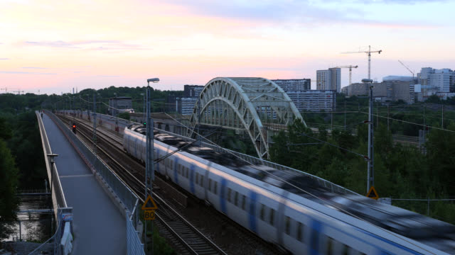 Commuter train passing by over bridge