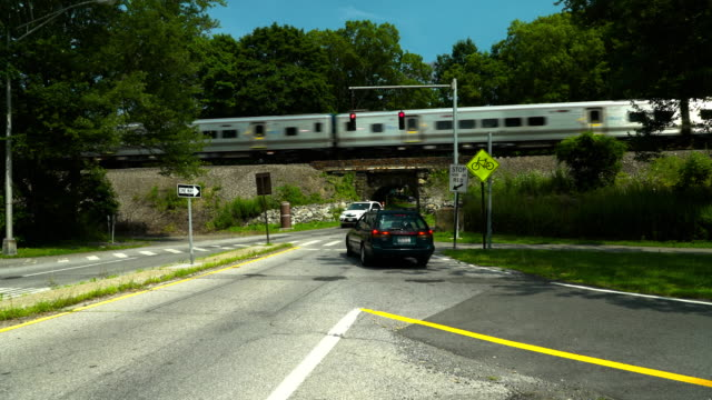 commuter train passing over a stone arch bridge in westchester - commuter train stock videos & royalty-free footage