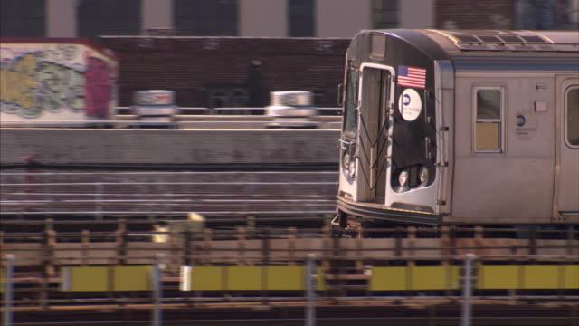 A commuter train travels through Queens.