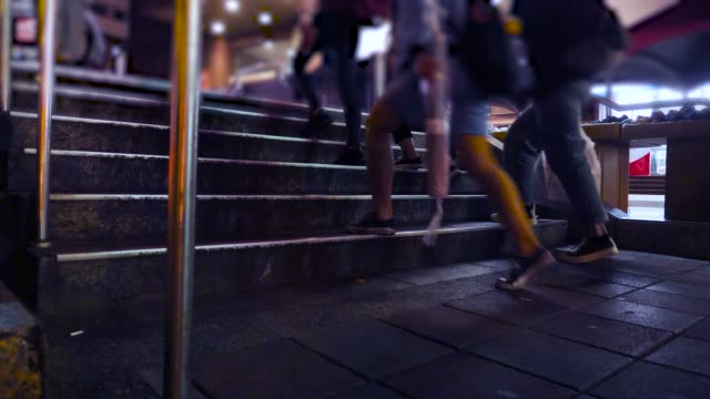 commuter walking on stairs in the city at night - staircase stock videos & royalty-free footage