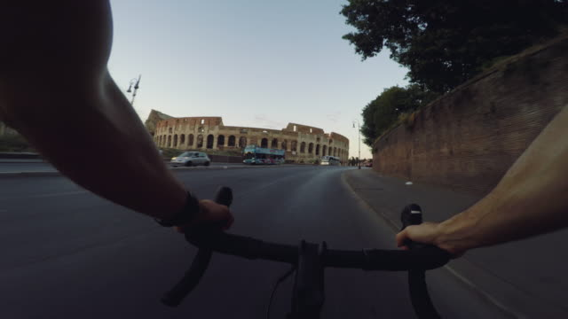 POV Commuter with racing bicycle in Rome: to the Coliseum