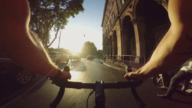 commuter with racing bicycle in the center of rome pov - point of view video stock e b–roll