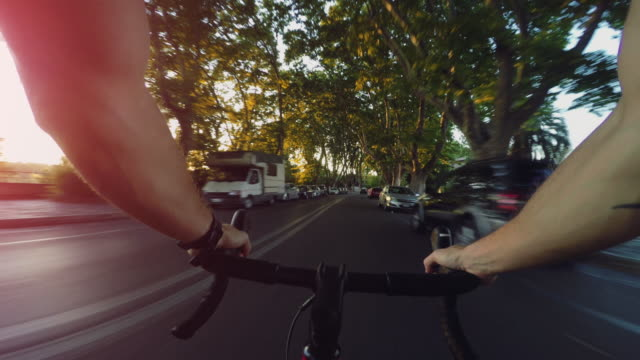 commuter with racing bicycle in the center of rome pov - handlebar stock videos & royalty-free footage